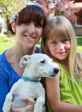 Family Pet. Portrait of mom and daughter with the family dog Stock Photography