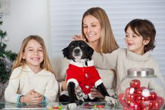 Family With Pet Dog At Home During Christmas royalty free stock photo