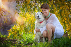 Family pet dog outdoors with female owner Royalty Free Stock Photos