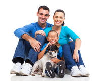 Family pet dog. Portrait of cute family sitting on floor with their pet dog isolated on white Royalty Free Stock Image