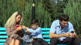 Family with phones stock video