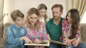 Family with photo album indoors. stock footage
