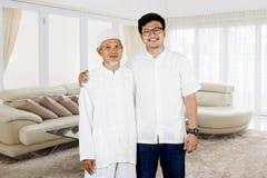 Family photo of father and son during Eid Mubarak celebration