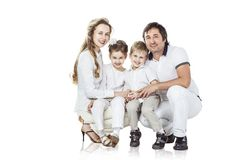 Family portrait: parents with daughter and son on white background. Family photo.happy family.parents and children.the photo has a blank space for text royalty free stock photo