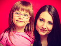 Family photo of mother and toddler daughter. Parenting, childhood concept. Family portrait photo of mother and little toddler daughter with eyeglasses Royalty Free Stock Photography