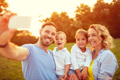 Family photo in nature. Young family taking photo in nature Stock Image