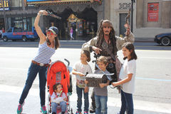 Family photo with Pirate Jack Sparrow Royalty Free Stock Photography