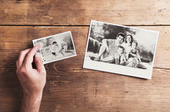 Family photos laid on a table Royalty Free Stock Image