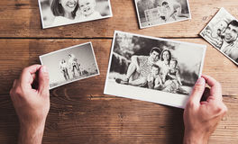 Family photos laid on a table Royalty Free Stock Photography