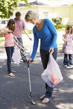 Family Picking Up Litter In Suburban Street Stock Photos