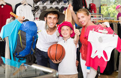 Family picking various clothing Royalty Free Stock Images