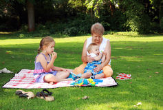 Family picnic. Kids have a small picnic with grandma Stock Image