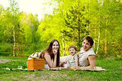 Family picnic. Young happy family having picnic in the nature Stock Photography