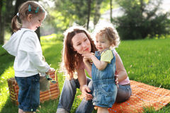 Family on picnic. Happy family on picnic in summer park stock image
