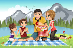 Family picnic. A illustration of a family having a picnic in a park vector illustration