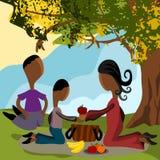 Family picnic. Abstract family having a picnic under a tree Royalty Free Stock Image