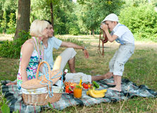 Family on a picnic. Son of photographs of parents mom and dad Stock Image
