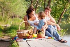 Family on picnic. Near the lake royalty free stock photo