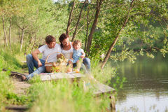 Family on picnic. Near the lake royalty free stock images