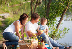 Family on picnic. Near the lake Stock Photo