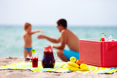 Family picnic on the beach. focus on food. Seaside family picnic on the beach. focus on food Royalty Free Stock Images