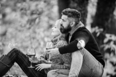 Family picnic. Happy couple. happy woman and bearded man drink wine. love date and romance. Spring mood. Red wine in. Family picnic. Happy couple. happy women royalty free stock image