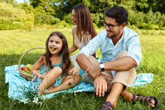 Family On Picnic. Happy Young Family Having Fun In Nature. Family On Picnic. Happy Beautiful Young Family Spending Leisure Time Together In Park, Kids Eating Royalty Free Stock Photos