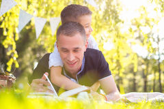 Family picnic. In the park royalty free stock photo