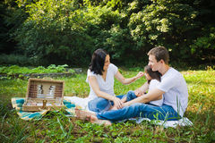 Family picnic in a park Stock Image