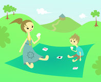 Family picnic time. A mother and a sun play cards on a blanket outside vector illustration