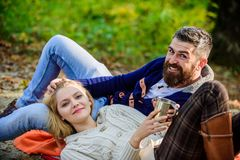 Family picnic. Valentines day. happy woman and bearded man drink mulled wine. love date and romance. Spring mood. Family picnic. Valentines day. happy women and stock image