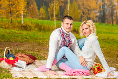 Family picnic young couple in autumn park Royalty Free Stock Photography