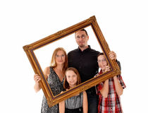 Family in picture frame. Stock Photo