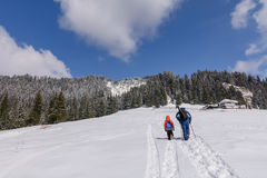 Family picture on winter mountain scene. Father and son in mount. Ain snow landscape Royalty Free Stock Photo