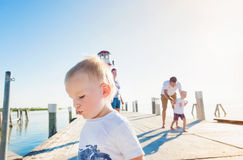 Family on the pier at the lighthouse, sunny summer Stock Image