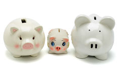 Family of piggy banks Stock Images