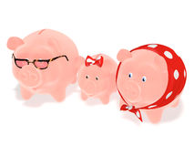 Family piggy banks. A family of three piggy banks on a white background Royalty Free Stock Photos