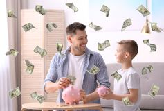 Family with piggy banks and money royalty free stock photo
