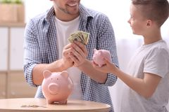 Family with piggy banks and money royalty free stock photography