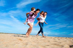 Family Piggyback on the Beach Stock Images