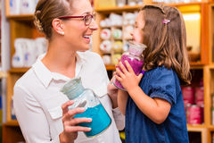 Family with pigment colors in store Stock Images