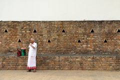 A family of pilgrims resting around the Temple of the Sacred Too stock photography