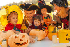 Family in pirate and witch costumes crafting Royalty Free Stock Photos