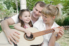 Family plaing guitar Royalty Free Stock Image