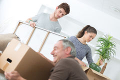 Family planing to accommodation on background boxes Stock Images