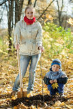 Family planting tree   in autumn Stock Photo