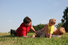 Family play. On meadow Royalty Free Stock Photo