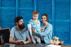 Family play with baby boy. Mother and father care about improving skills of toddler to prepare him to kindergarten and Royalty Free Stock Image