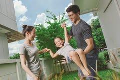 Family play in backyard Royalty Free Stock Photos