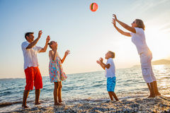 Family play on beach Stock Images